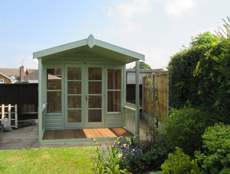 Morston Summerhouse that has a veranda and roof overhan